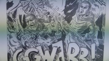 Des planches de bandes dessinées de Hugo Kowalak, sont exposées.